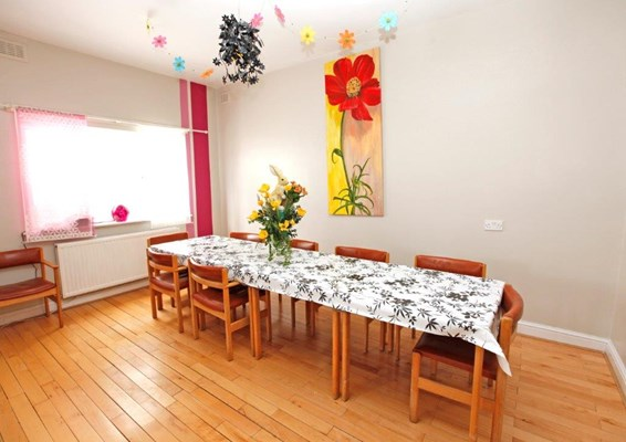 Communal dining room where residents come together to share mealtimes
