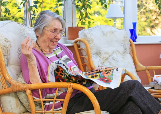 One of our residents enjoying her hobbies in the conservatory