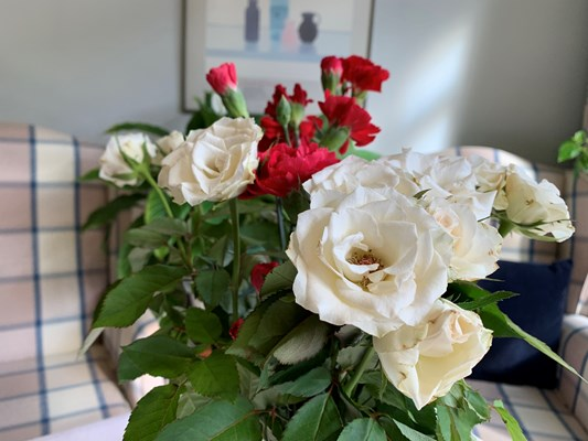 Beautiful roses and carnations in vase at Abbeyfield House, Dulwich