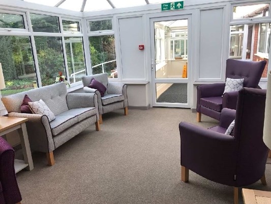 A seating area within a conservatory