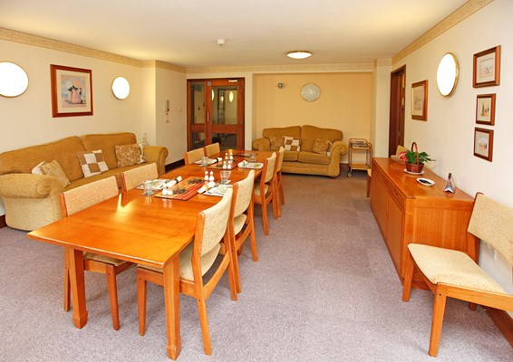 Lounge dining area with large table and sofas