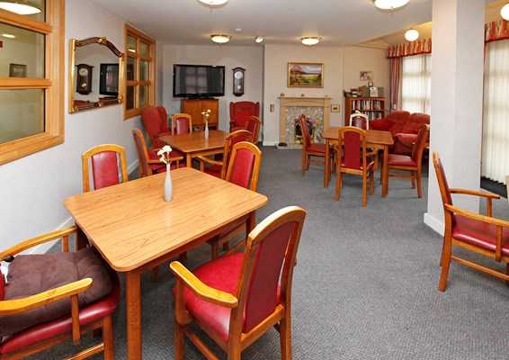Tables and chairs in the dining room at Millenium House