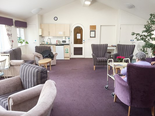 Modern, spacious communal lounge with kitchenette where residents can socialise and catch up with friends and family