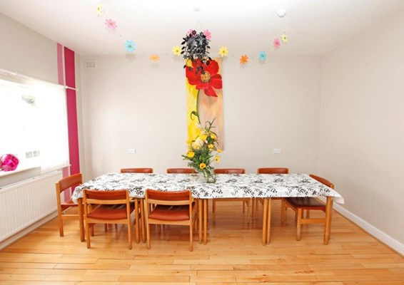 Bright dining room at Father Popieluszko House