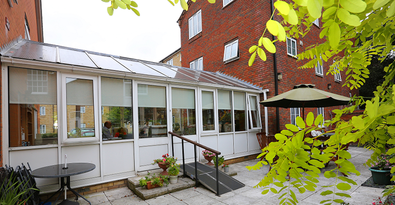 Conservatory at Serenus Court with views of the beautiful garden