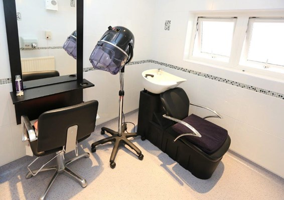 Modern hairdressing room for residents to use