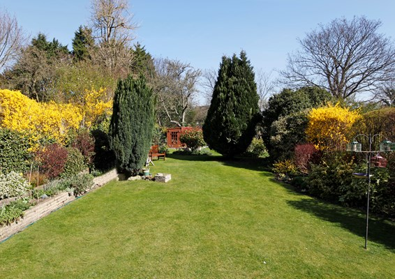 Large, long and sunny garden with summer house and bench for residents to sit and enjoy the sunshine and peace and quiet