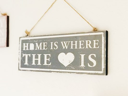 Home is where the heart is sign on the wall