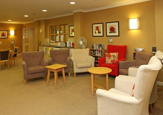 Armchairs in a semi-circle in the lounge dining area where residents can relax and catch up