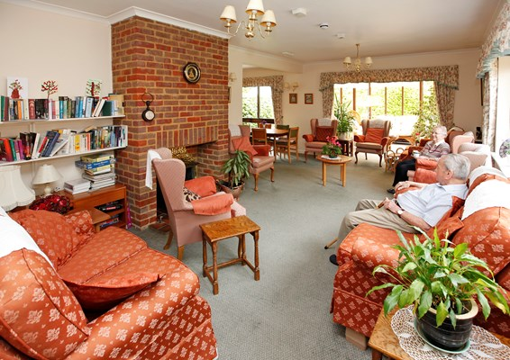 Residents spending time together in the communal lounge at Annett House
