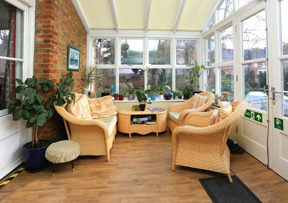 Bright conservatory where residents can catch up