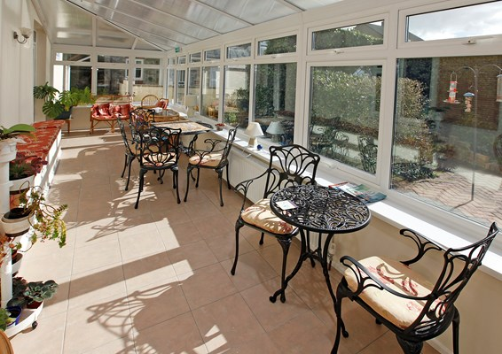 Sit back and relax in our conservatory