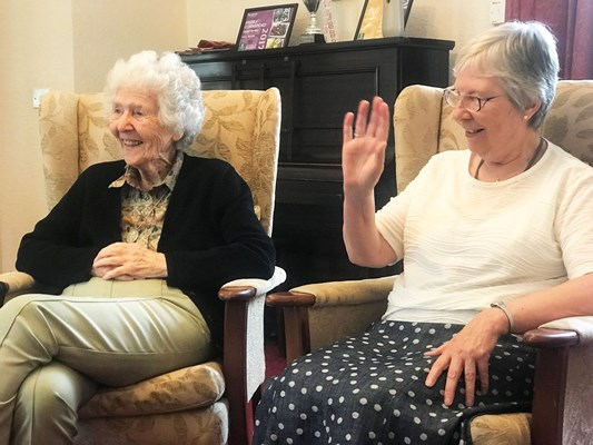 Residents enjoying conversation in the lounge