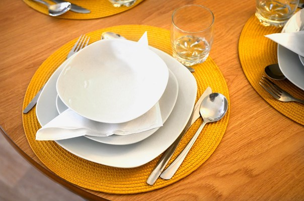 Close up of a place setting on a dining table