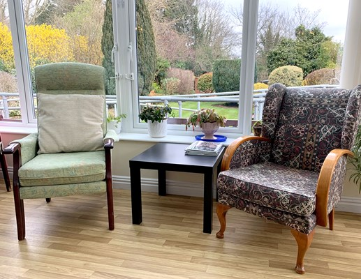 Seats by the window where residents can enjoy the view in the garden, catch up or do some reading