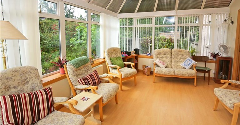 The conservatory with ample seating for residents