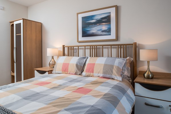 Double bed with a checkered bedspread