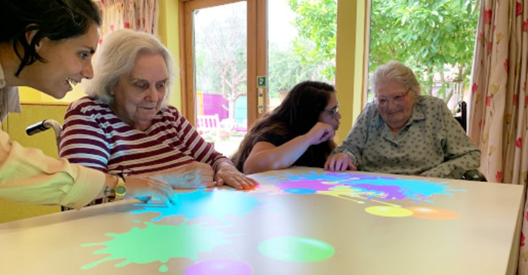 Residents playing a game together on the omiVista