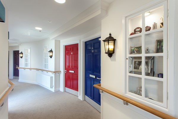 Each bedroom has a brightly coloured door complete with letterbox and street lamp