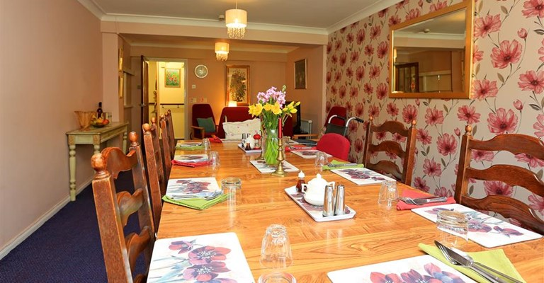 Set dining room table where residents share meals together