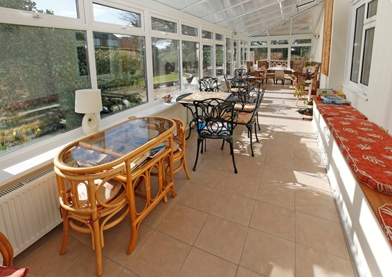 Entertain family and friends in our sun room