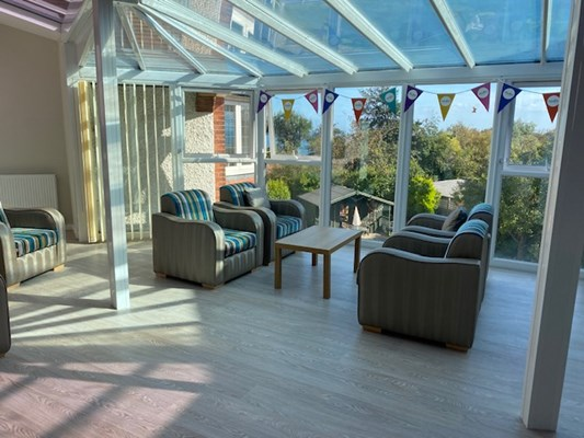 The conservatory seating area with bunting on the windows