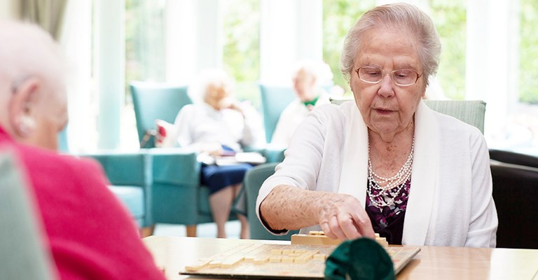Residents enjoying a game of scrabble