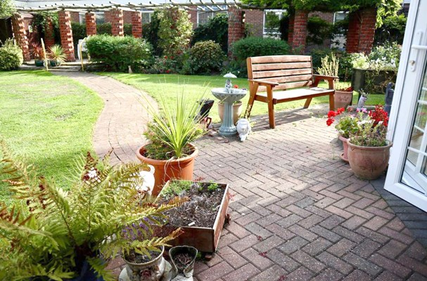Patio area in the garden where residents can sit and enjoy the sunshine
