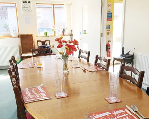 Bright communal dining room where residents enjoy socialising over meals