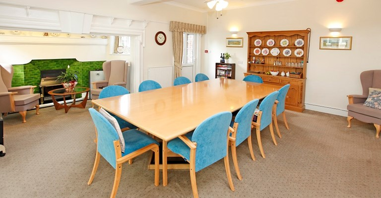 Communal dining room where residents can enjoy delicious home cooked meals at Sibleys Orchard