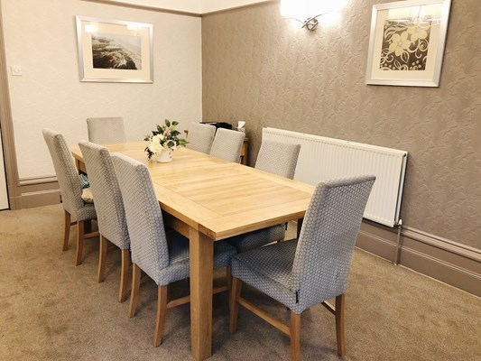 Long modern dining table with high backed chairs