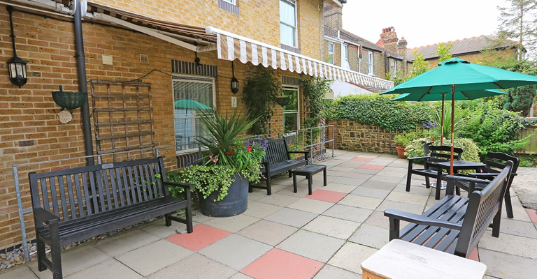 The level patio area is perfect for enjoying the warmer months outside