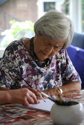 One of our residents concentrating on her watercolour painting