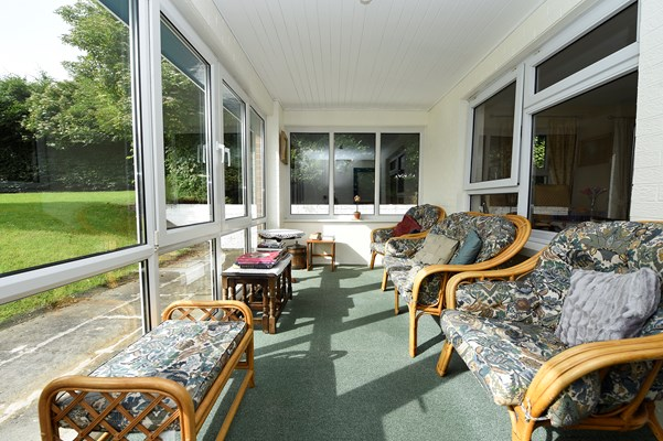The conservatory lounge area overlooking the garden