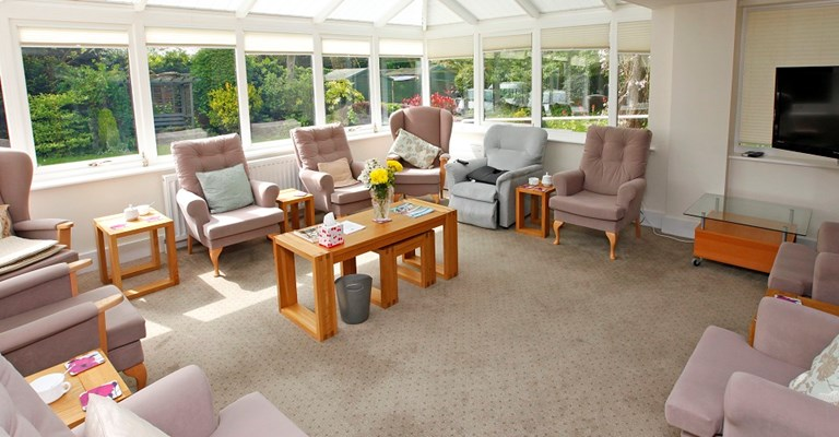 Bright and airy communal lounge where residents can enjoy socialising and catching up with friends and family
