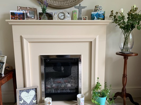 A fire place with photos and ornaments