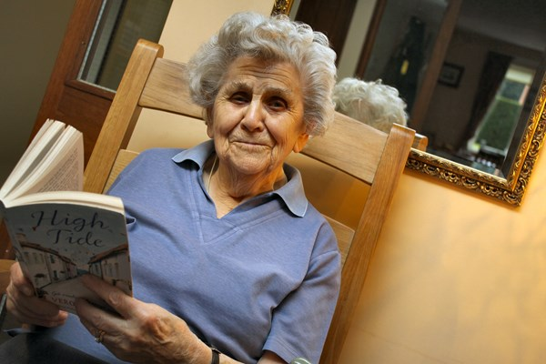 A resident sat reading a book