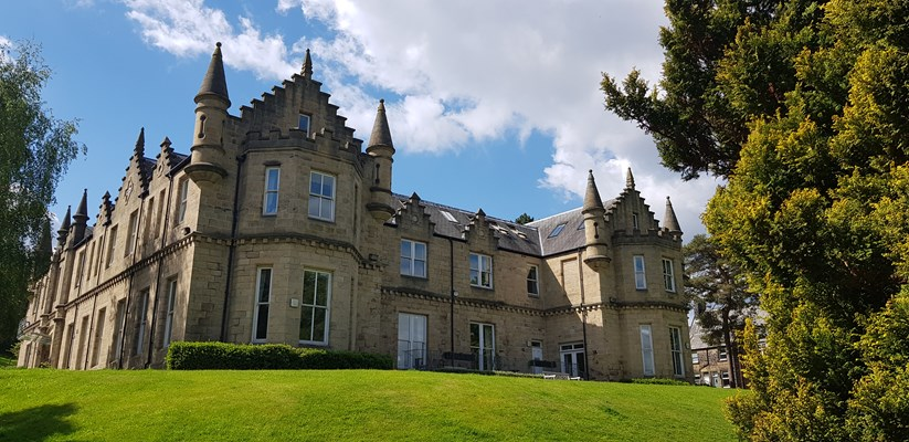 Rear view of the stunning stone house and its gardens