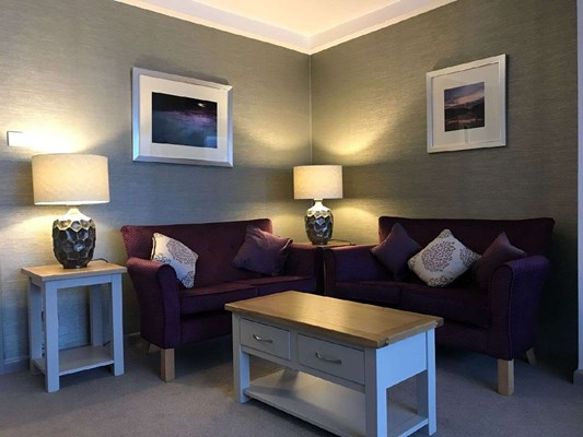 Cosy seating area with lamps and sofas