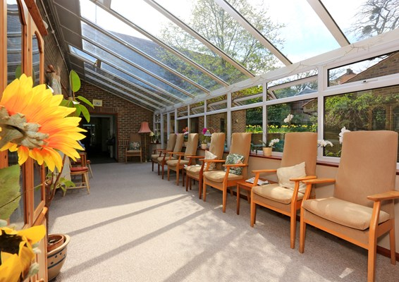 Large, bright conservatory where residents can relax, socialise or enjoy the views in the garden