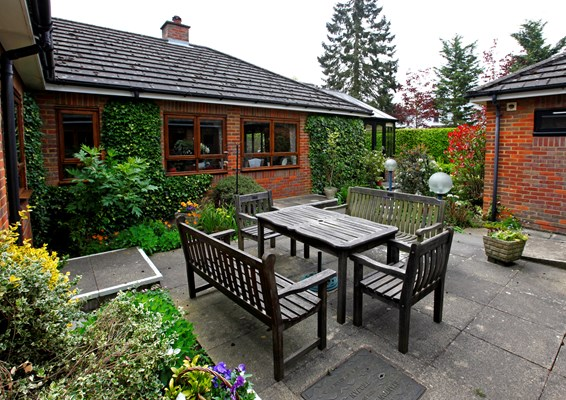 Table and chairs in garden where residents can enjoy the sunshine at Annett House