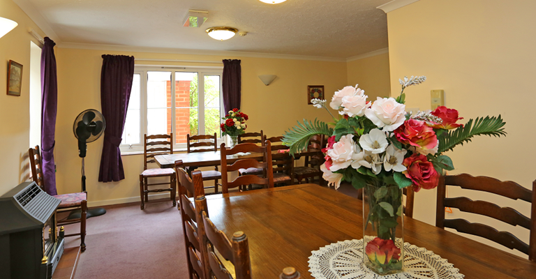 Communal dining room where residents share meals together