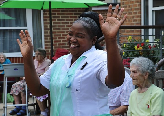 Happy member of staff enjoying herself at a outdoor event in the garden