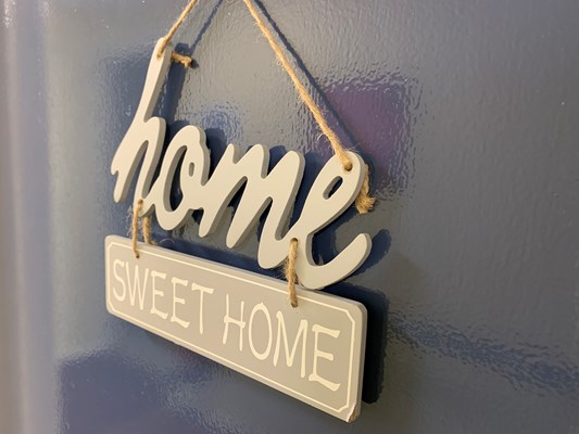 A home sweet home sign hung on the wall
