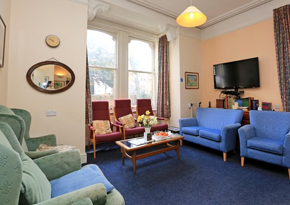 Communal lounge with plenty of seating where residents can socialise together