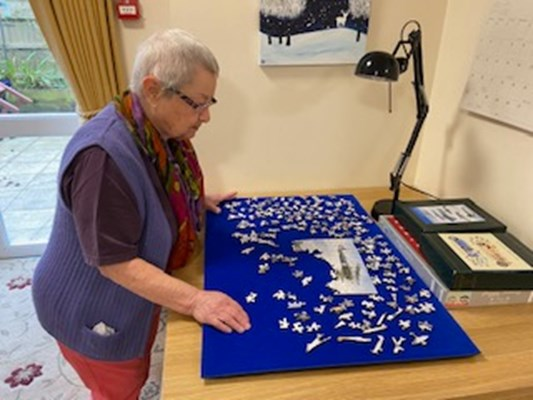 One of our residents completing a puzzle
