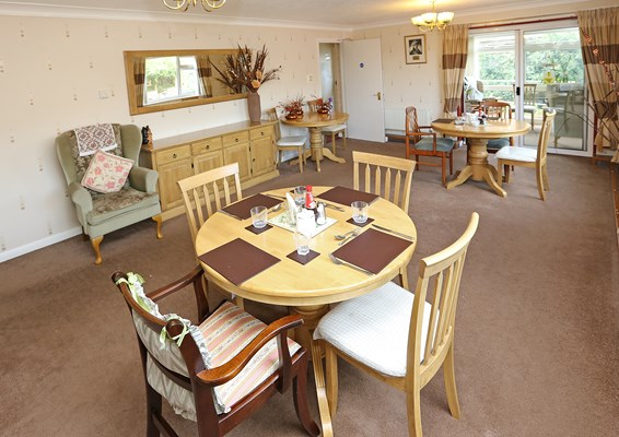 Bright and spacious dining room for residents at Abbeyfield House, Great Yarmouth