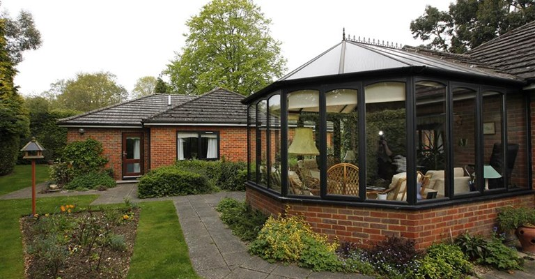 Communal conservatory overlooking the garden
